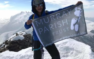 The Murray Parish Trust flag flies high in Switzerland – Shadi did it!