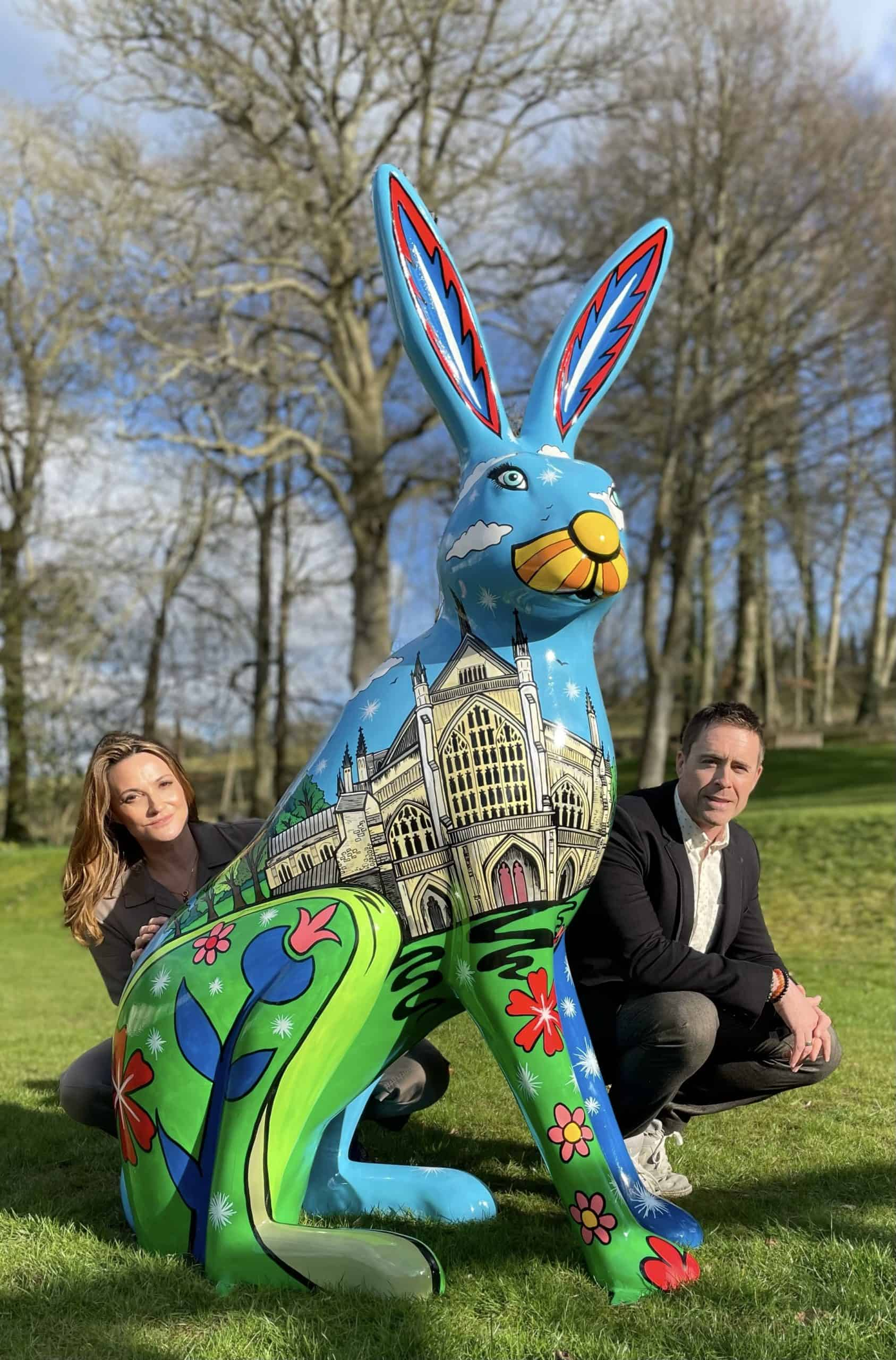 Sarah Parish and James Murray from The Murray Parish Trust pictured with a painted Hare Sculpture by artist Jenny Leornard showing images of historic Winchester